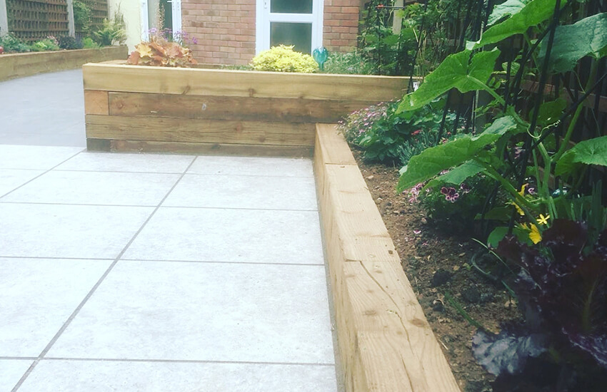 Garden borders decorated with timber sleepers
