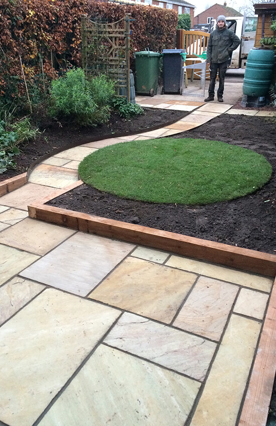 Sandstone patio and grass garden