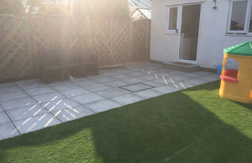 Granite paving and artificial lawn in Longwell Green